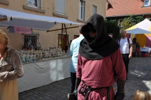 Characters dressed in medieval garb: this one, carrying an executioner's ax
