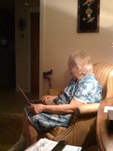 My grandmother on my laptop, looking at photos of the kids