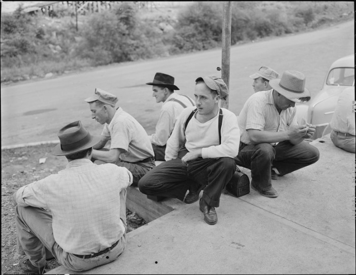 Wikimedia Commons: Miners waiting for the bus to take them to Richlands after they have washed up at the bathouse. Jewell Ridge Coal Company, Jewell Valley Mine, Jewell Valley, Tazewell County, Virginia.