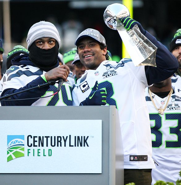 Russell Wilson and Marshawn Lynch celebrating the Super Bowl XLVIII victory in Seattle, 02.05.2014 - Wikimedia Commons