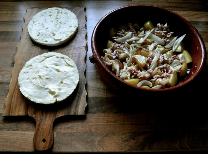 The French Savoie 'Tartiflette' dish, in the kitchen with pinklightsabre