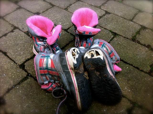 Two pairs of kids' boots after 90 days in the UK